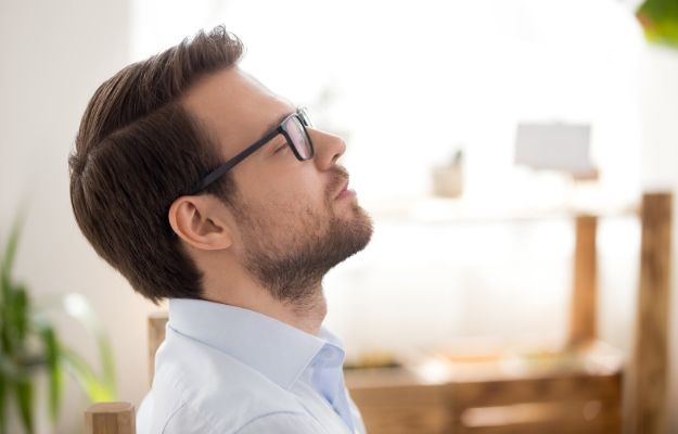 Close up of attractive millennial businessman relaxing after work breathing fresh air   Breathe Through Your Nose   How To Breathe Better: 4 Breathing Exercises Anyone Can Do