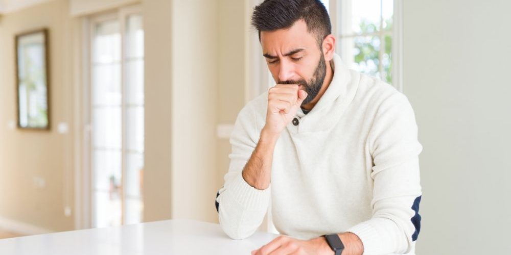 Handsome man wearing casual white sweater at home feeling unwell and coughing   Feature   Cough Frequency: What Do We Know?