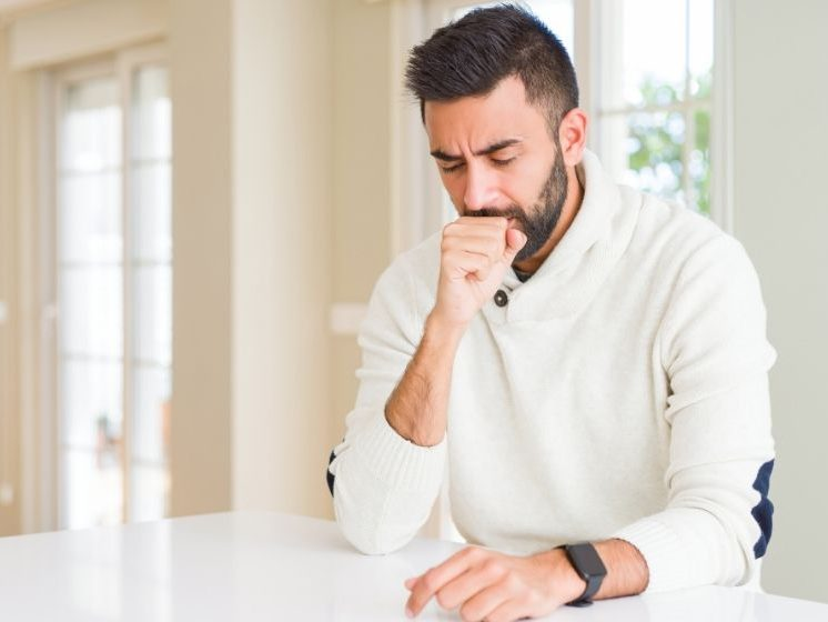 Handsome man wearing casual white sweater at home feeling unwell and coughing | Feature | Cough Frequency: What Do We Know?