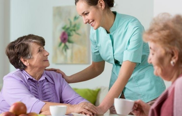 a nurse taking care of elders | Love one | Who are Hyfe's Customers? | A Look Into Hyfe's Audience