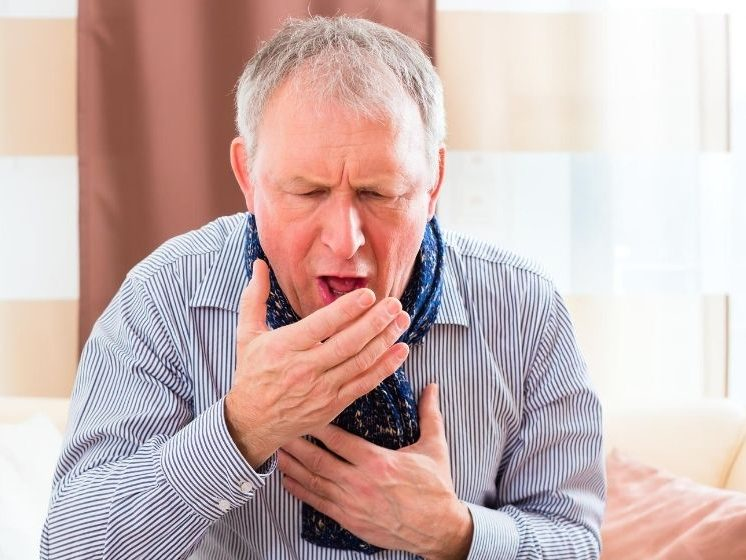 an old man is coughing and take his hands to cover mouth | Feature | Coughing After Eating | What Does It Mean?