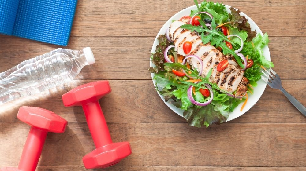 a bottle of water, a dish of salad and a red dumbbell | 6 Good Healthy Habits and How to Form Them | featured photo