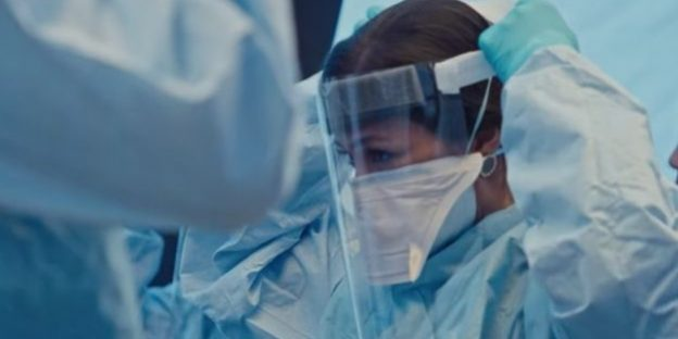 a woman wearing protective clothing | Cough Tracking Lesson From Pandemic Movie | Why Cough Tracking Is A Valuable Diagnosis Tool