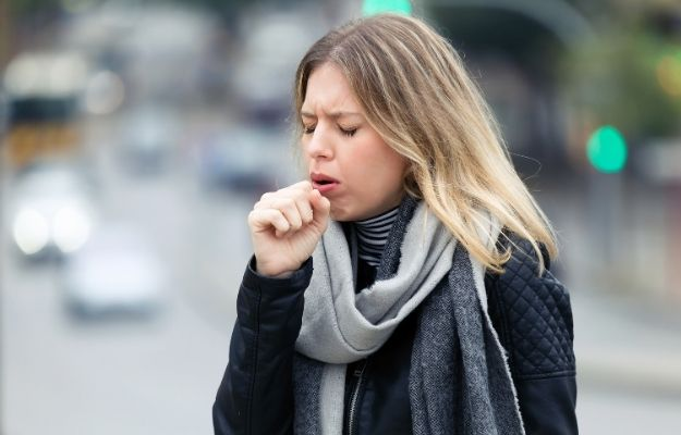 a woman wearing scarf is coughing | Diagnostics for Everyone That Coughs | Hyfe App: Diagnostics For Everyone