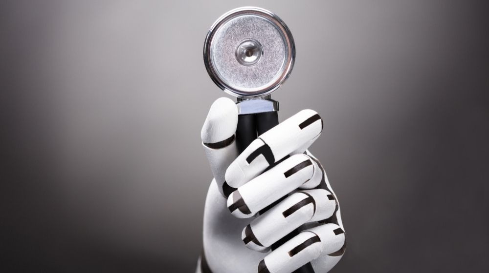 Close-up Of A Robot's Hand Holding Stethoscope - ss - featured photo | What if We Had AI Diagnostic On Our Phones?