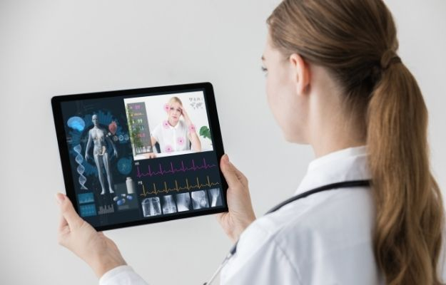 a doctor is holding a tablet with the patient image | The Future of Telemedicine in 2020 and Beyond | What Is Telemedicine?