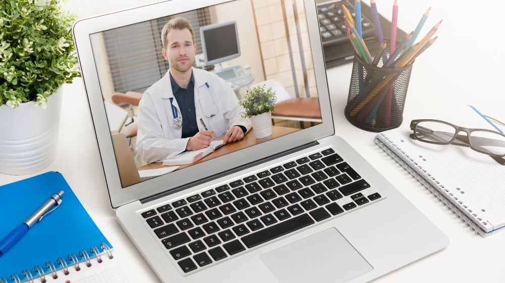 a doctor picture in an laptop screen - ca - | featured photo | The Future of Telemedicine in 2020 and Beyond