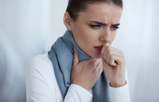 a woman wearing scarf is coughing | COVID or Flu? How to Track Your Health This Flu Season | Persistent Cough and COVID