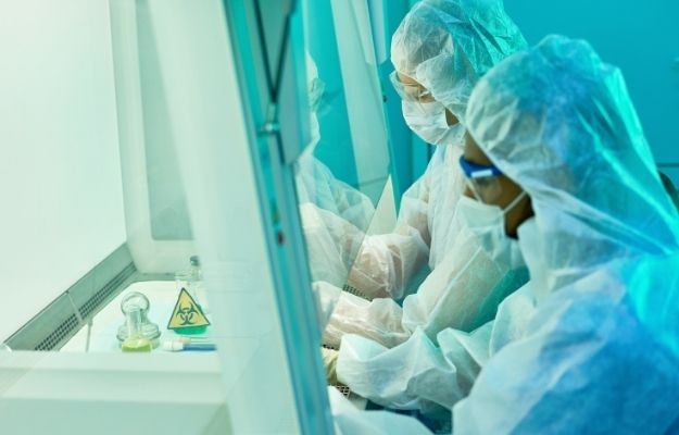 two scientists are wearing protection suits and working together-ca | Epidemiology: The Study of The Spread of Health-Related Events Within A Population | What Is Epidemiology?