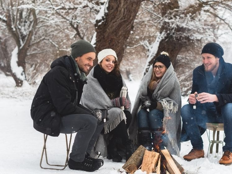 Group having a good time during winter - Feature - CA | How To Stay Healthy In Winter 2020 | Feature