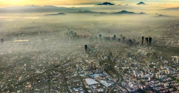 Smoggy sky over a big city | How Ambient Air Pollution Affects Our Health | How does poor air quality affect your health?