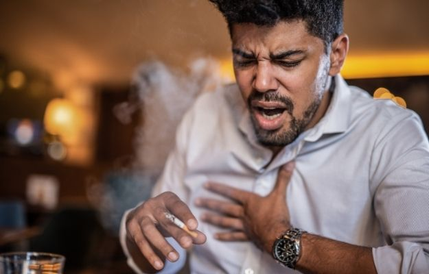 Male smoker coughing while smoking - How to Get Ri…ough That Won't Go Away, but I'm Not Sick - CA | I Have a Cough That Won't Go Away But I'm Not Sick: FAQs | How to Get Rid of It When I Have a Cough That Won't Go Away, but I'm Not Sick