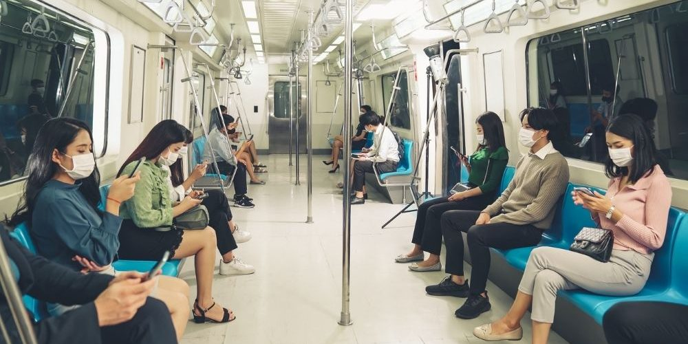 People riding on the train - FE - CA   How Herd Immunity Benefits Everyone   How It Works   feature