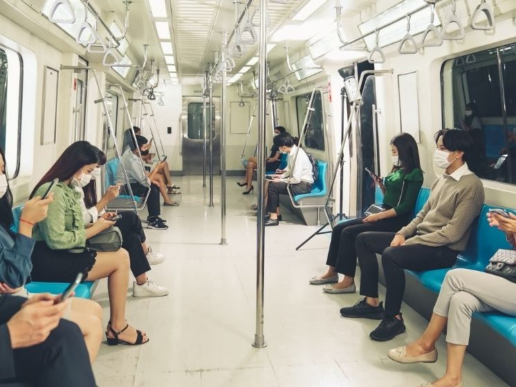 People riding on the train - FE - CA | How Herd Immunity Benefits Everyone | How It Works | feature
