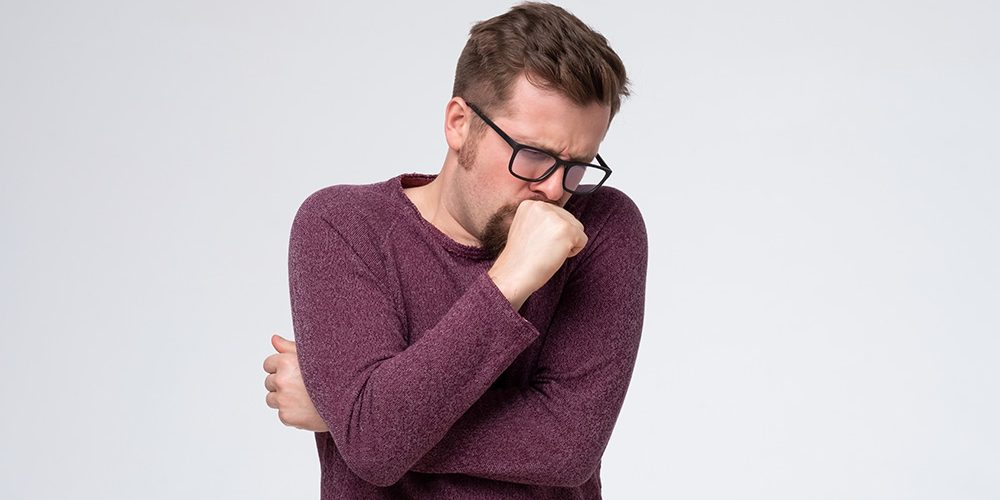 man in wolen sweater cover a cough - SS - Feature   Productive vs. Nonproductive Cough   Feature