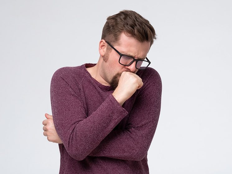 man in wolen sweater cover a cough - SS - Feature | Productive vs. Nonproductive Cough | Feature