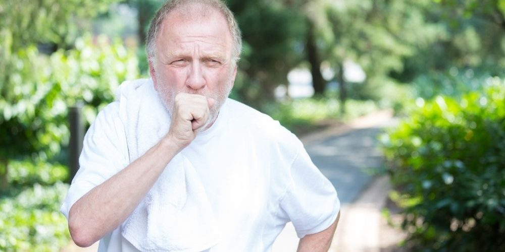 Elderly man coughing while cover his mouth with his hand | Feature | What Happens If Whooping Cough Is Left Untreated | What Does Whooping Cough Sound Like