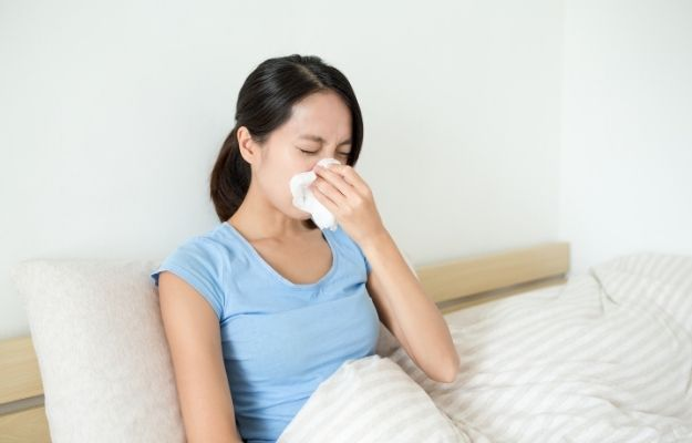 Girl lying in bed wiping her nose - How Do You Know If You Have Whooping Cough | How Do You Know If You Have Whooping Cough | What Does Whooping Cough Sound Like