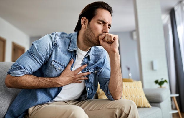 Man-having-chest-pain-caused-by-severe-coughing | What Are the 4 Stages of COPD? Stage 4 | What Are the 4 Stages of COPD?