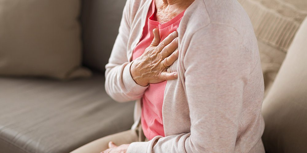 elder woman holding her chest | feature | What Is Hiatus Hernia Cough? Facts and How to Stop It