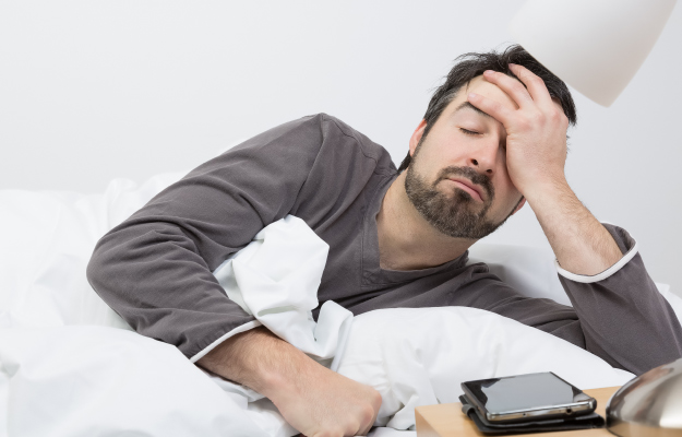 middle-aged-man-waking-up-tired | What Are the Symptoms of Periodical Breathing? | What Is Periodic Breathing - What Can I Do?