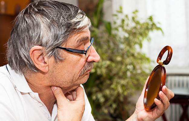 senior man looking at the mirror | What Are the Causes of Hiatus Hernia Cough? | What Is Hiatus Hernia Cough? Facts and How to Stop It