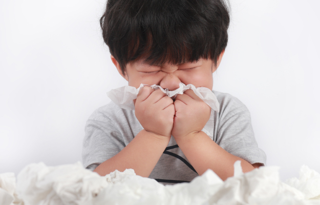 sick-little-Asian-boy-wiping-or-cleaning-nose-because-of-allergy | Allergies | My Child Has a Cough. What Should I Do?