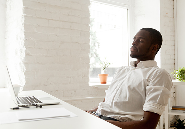 African american man relaxing after work breathing fresh air   Still Coughing After Covid? Here's What To Do   How to Control Your Cough After Covid