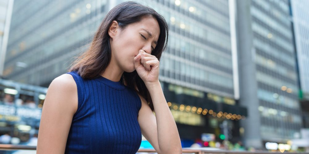 Woman-cough-at-outdoor   Feature   Chronic Cough Negatively Impacts Quality of Life, Study Shows
