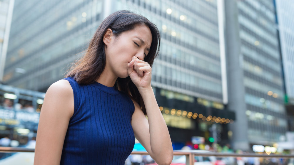 Woman-cough-at-outdoor | Feature | Chronic Cough Negatively Impacts Quality of Life, Study Shows