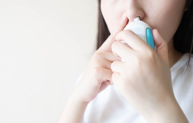 Young-female-using-steroid-nasal-spray | Chronic Cough Negatively Impacts Quality of Life, Study Shows